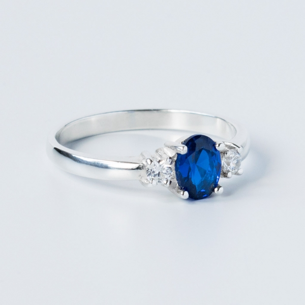 sterling silver ring with blue sapphire and white cubic